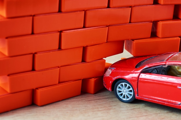Ð¡ar crash accident. automobile hit a brick wall. a car insurance concept