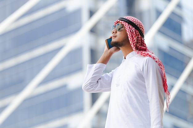 Arab business man call phone working in the city