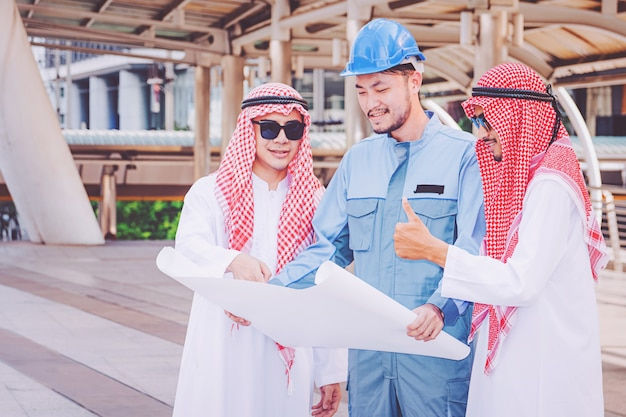 Arab businessman and engineer meeting project at construction site
