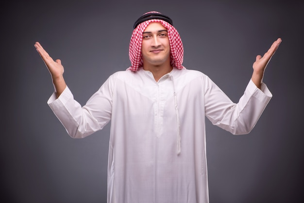 Arab businessman on gray