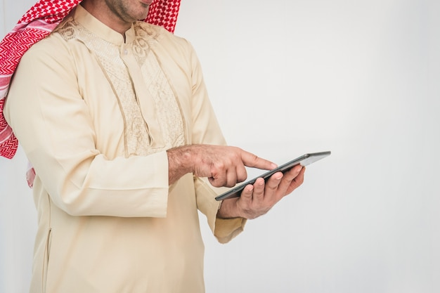 Arab businessman useing on a mobile phone