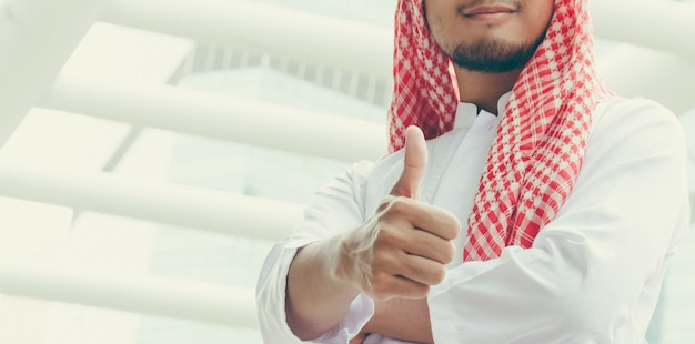 Arab businessmen  showing thumb up because the job was successful.