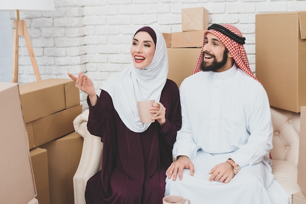 Arab couple owners of apartment look at interior