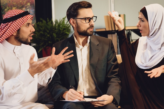 Arab couple at therapist reception quarrel.