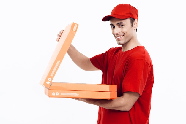 Arab deliveryman open pizza on white background.