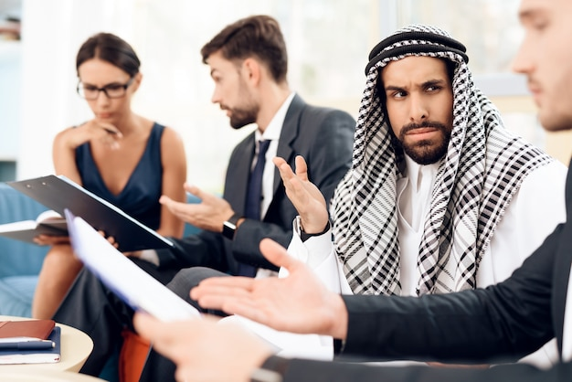 Arab discusses business with people.