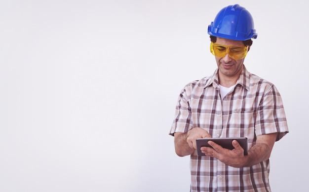 Arab engineer man wear blue cap safety helmet