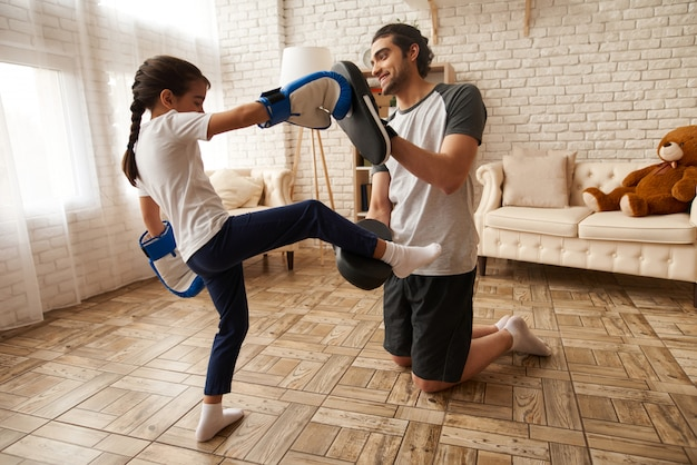Arab family. man and young girl have boxing training.