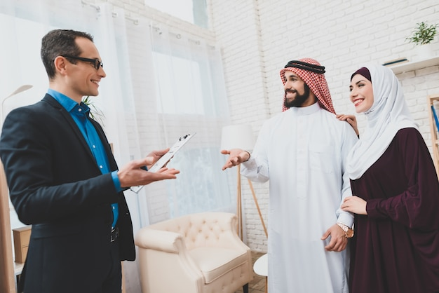 Arab family and real estate manager. man in keffiyeh.