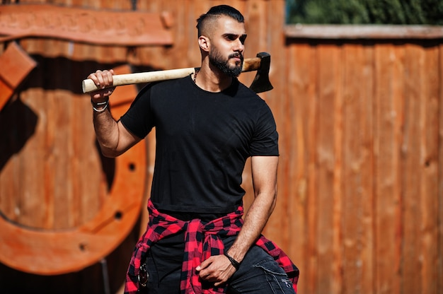 Arab hipster beard man lumberjack hold axe