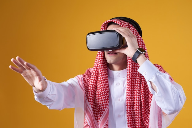 Arab man posing in virtual reality isolated.