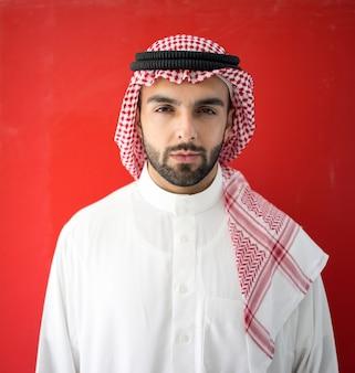 Arab man on red background