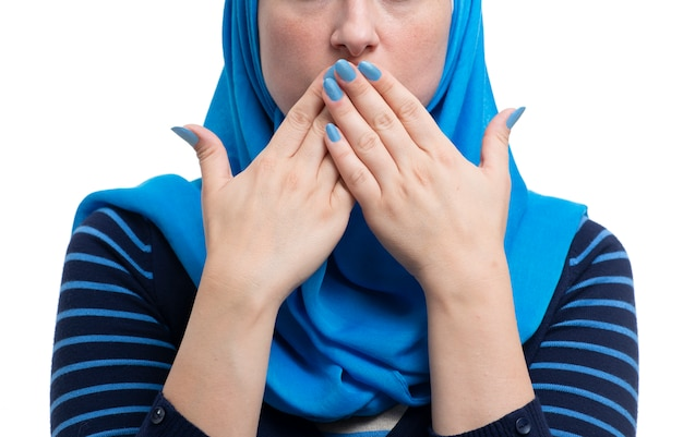 Arab muslim female covering her mouth isolated on white backgound