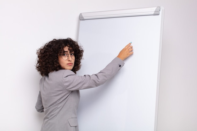 Arab pretty woman with a white board.