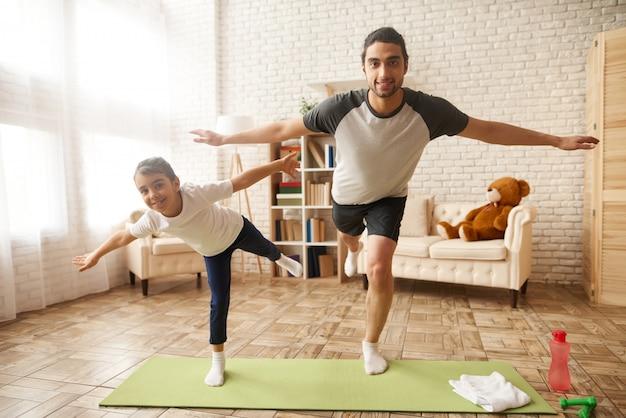 Arab sport family. man and girl plane standing.