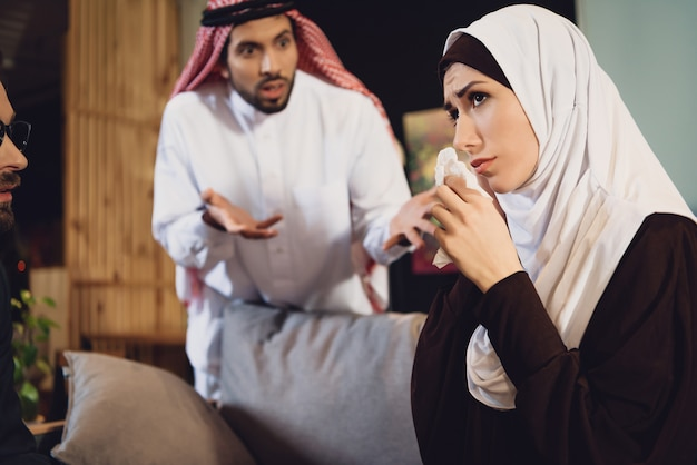 Arab woman with husband at psychologist reception