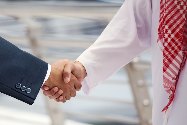 Arabian business men shake hand and discuss together for success concept