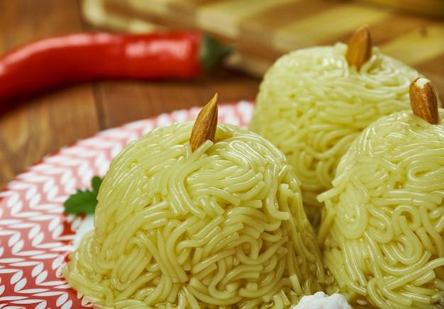 Arabian cuisine - halawet ahmad, arabic dessert, traditional assorted  dishes, top view.