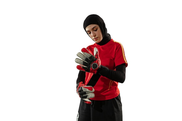Arabian female goalkeeper on white studio wall
