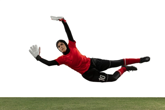 Arabian goalkeeper on white studio wall