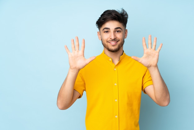 Arabian handsome man over isolated counting ten with fingers