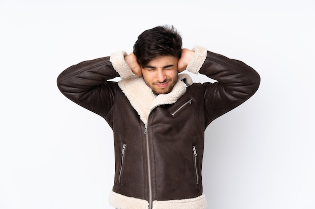 Arabian handsome man over isolated frustrated and covering ears
