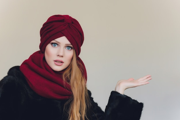 Arabian lady wearing red wool cap