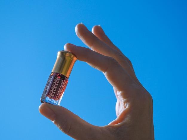 Arabian oud attar perfume or agarwood oil fragrances in mini bottle.