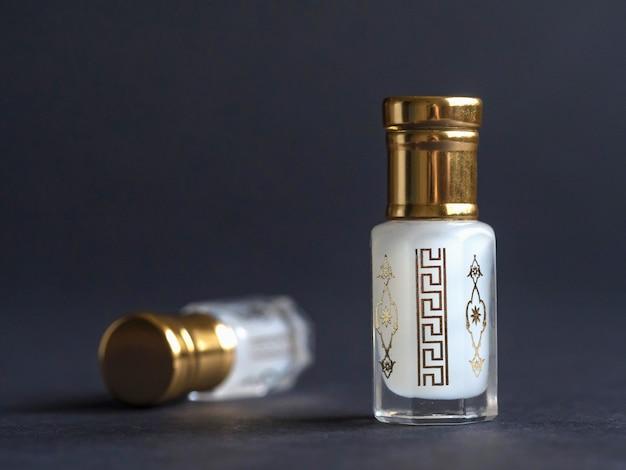 Arabian oud attar perfume or agarwood oil fragrances in mini bottles.