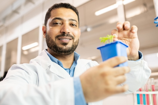 Arabian scientist in seedling laboratory