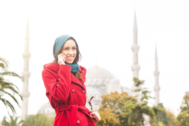 Arabian woman wearing veil in front of a mosque in istanbul
