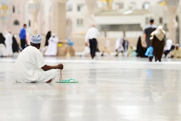 Arabic african man praying at harem
