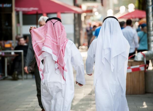 Arabic businessmen walking on the street