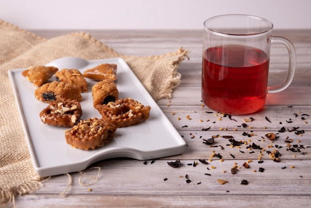 Arabic chebakia sweets and a drink on wooden table