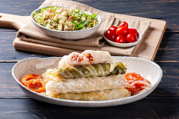 Arabic food. appetizing cabbage rolls on wood