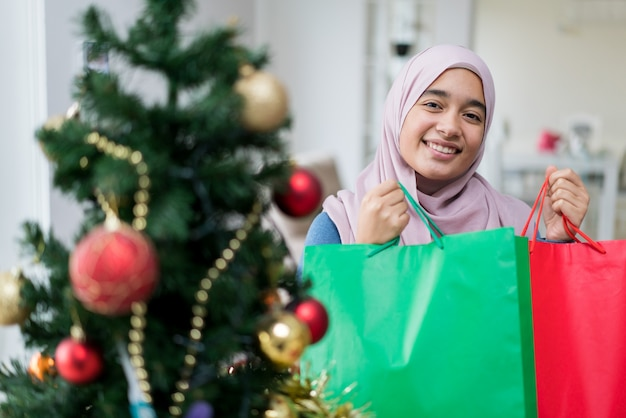 Arabic girl with new year holidays tree