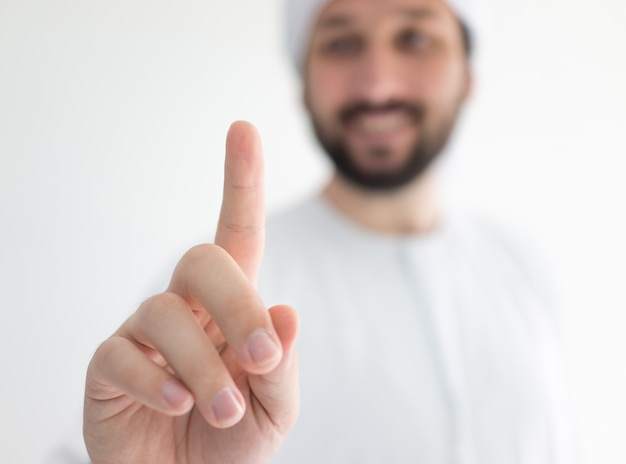 Arabic man wearing traditional clothes pressing abstract button for your message