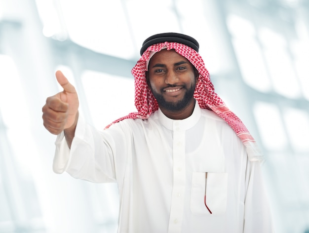 Arabic middle eastern black man with thumb up