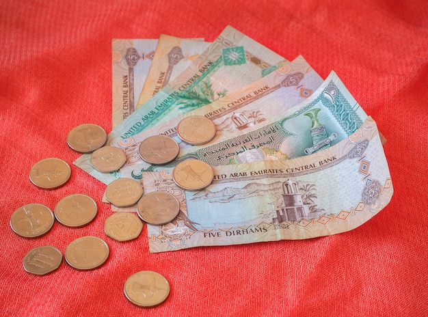 Arabic money dirham currency notes and coins.