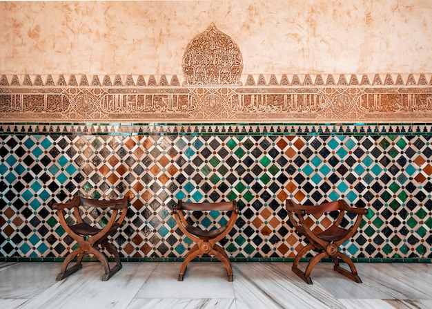 Arabic mosaic with chairs in the alhambra in granada
