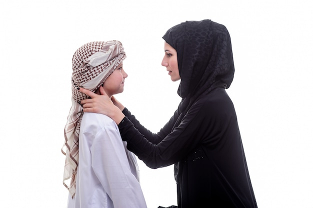 Arabic mother and son posing indoors.