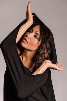 Arabic muslim girl wearing black robe over white