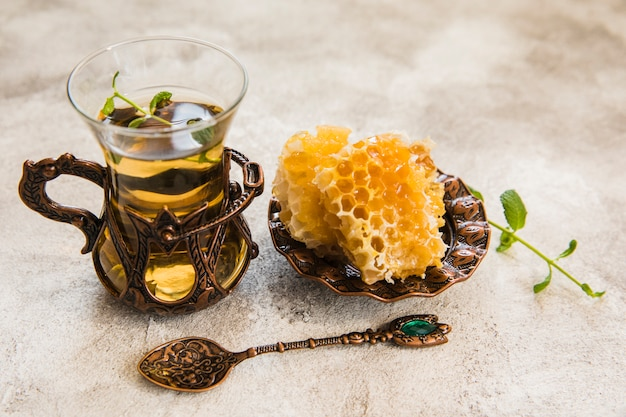 Arabic tea glass with honeycomb on table