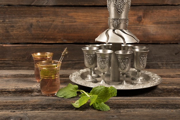 Arabic tea in glasses with cups on tray