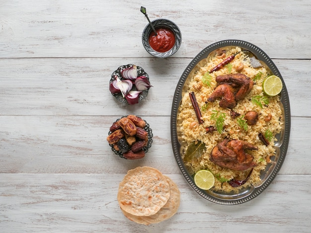 Arabic traditional food bowls kabsa with meat