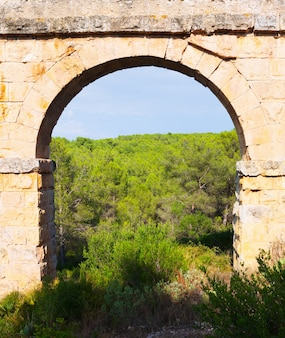 Arch of antique roman aqueduct