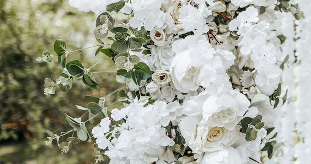 Arch decor with white flowers for a wedding ceremony in nature