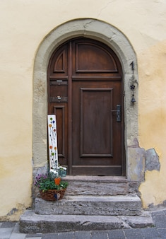 The arch door on the pale yellow wall in europe
