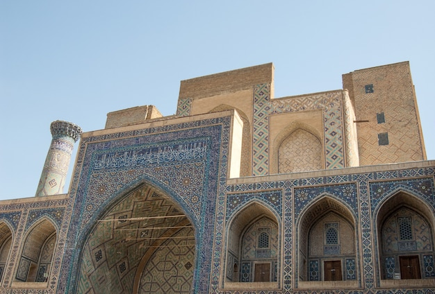 The arch and the exterior design of the ancient registan in samarkand ancient architecture of asia
