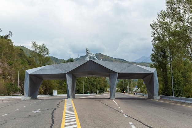 Arch in kazakhstan. metal arch with the statute of leopard on the peak.